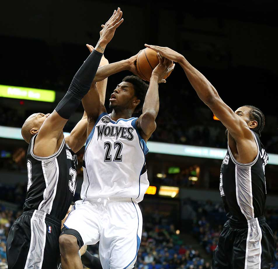 Andrew Wiggins of Minnesota attempts to penetrate the San Antonio Spurs defense.