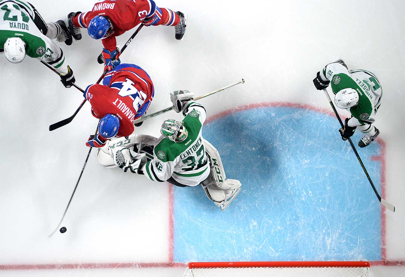 Phillip Danault of Montreal scores a goal against Kari Lehtonen of the Dallas Stars.