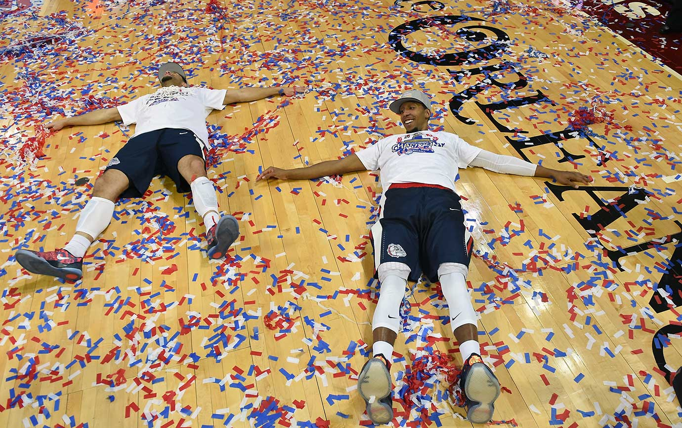 Josh Perkins, left, and Eric McClellan of the Gonzaga Bulldogs celebrate their 85-75 win over Saint Mary's in the West Coast Conference title game.