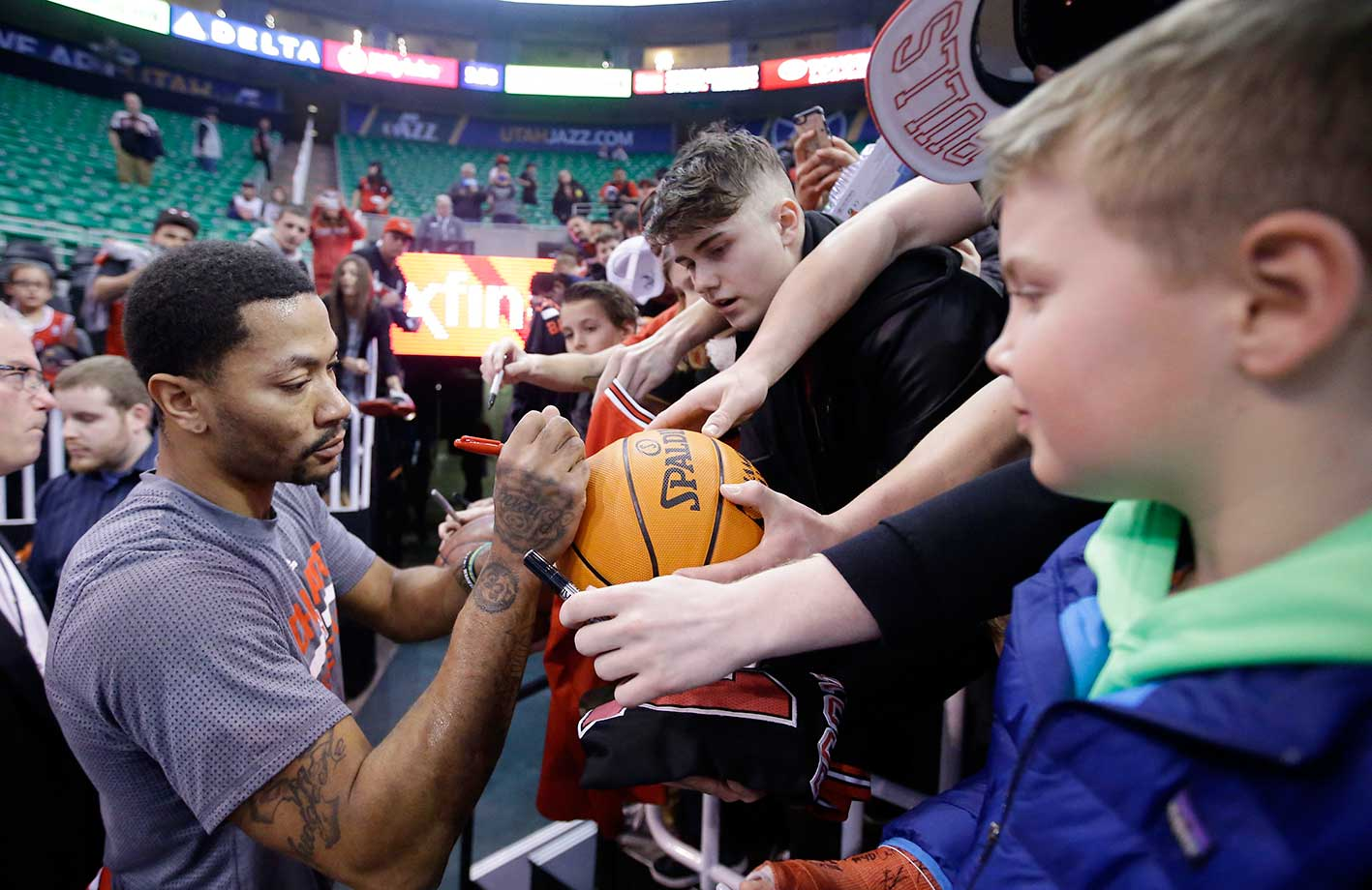 Chicago Bulls guard Derrick Rose signs autographs during practice before the start of a game against the Utah Jazz in Salt Lake City.