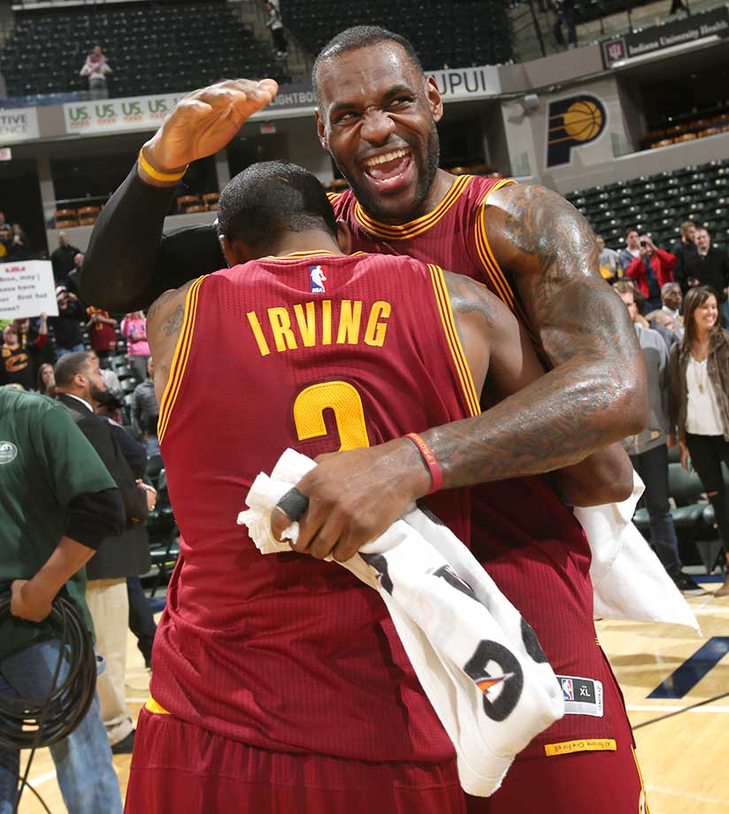 LeBron James and Kyrie Irving of the Cleveland Cavaliers celebrate after their victory over the Indiana Pacersat Bankers Life Fieldhouse in Indianapolis.