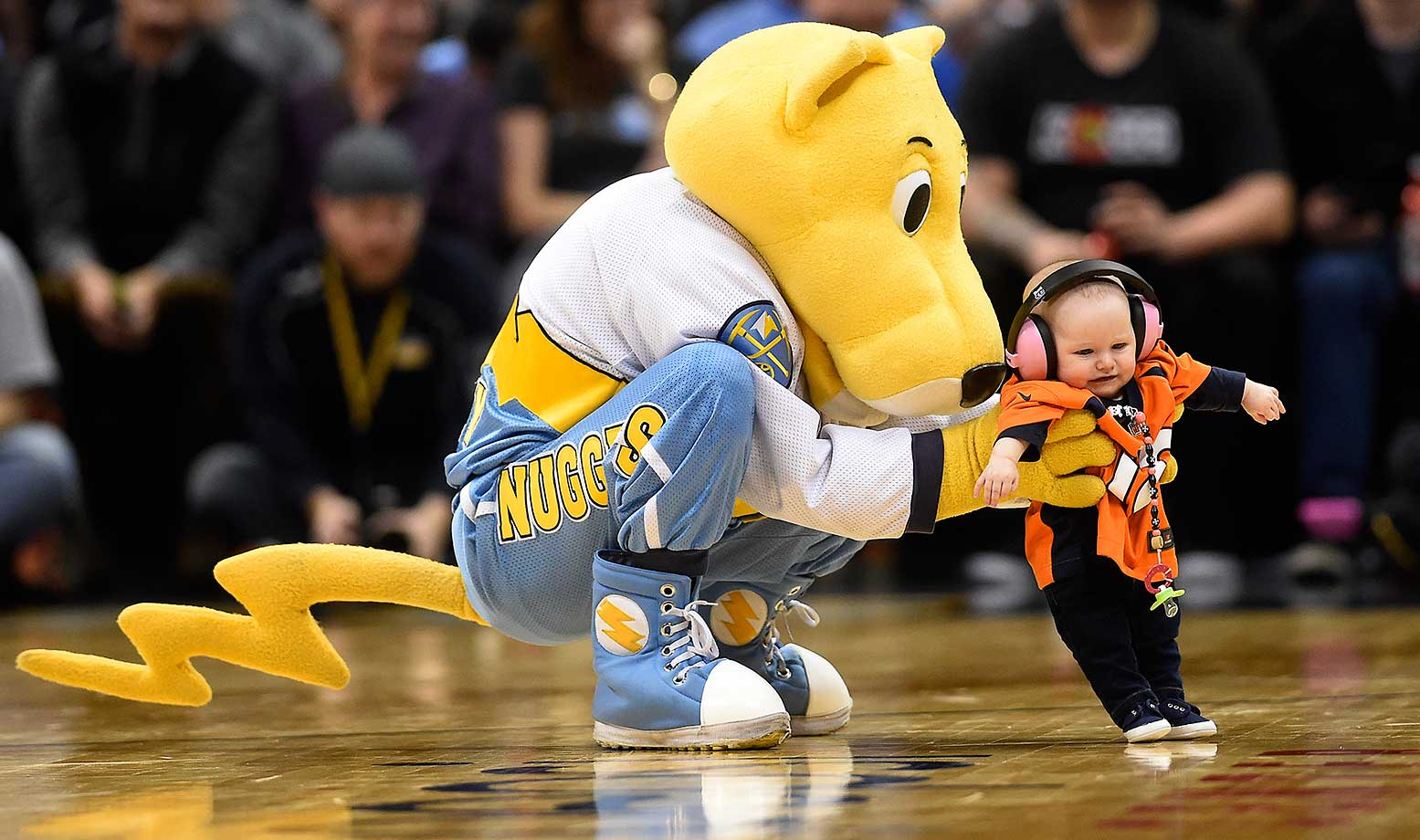 Denver Nuggets mascot Rocky dancing with a small child in a Broncos jersey during the Nuggets' 112-93 win over the Toronto Raptors at the Pepsi Center.
