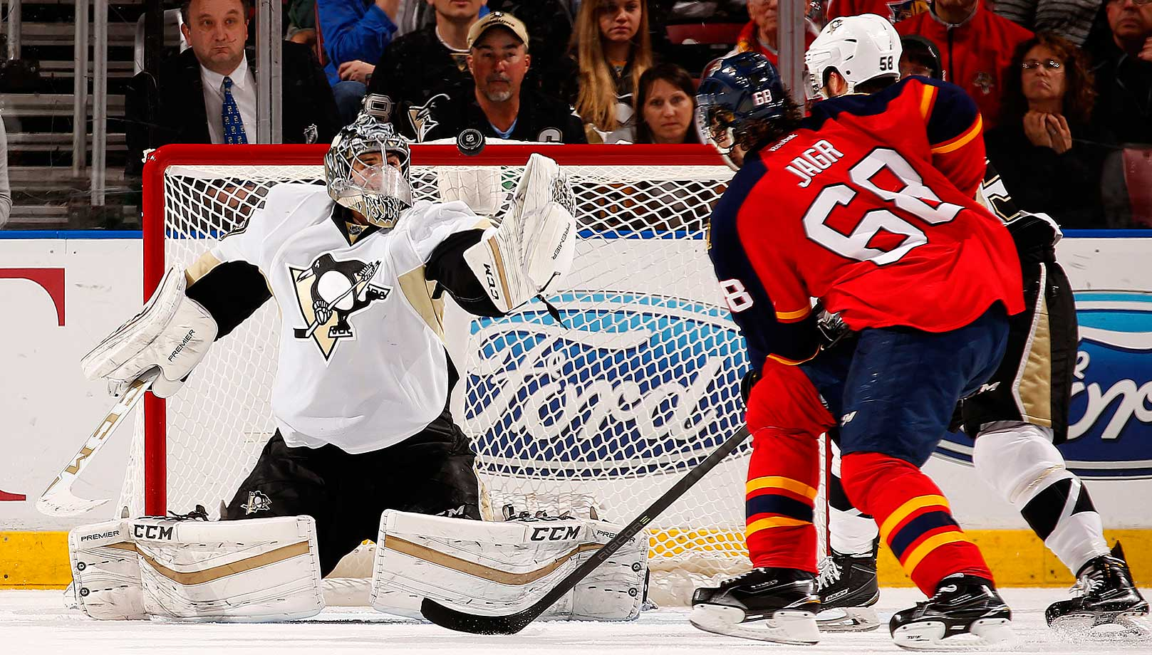 Marc-Andre Fleury of the Pittsburgh Penguins defends the net against Jaromir Jagr.
