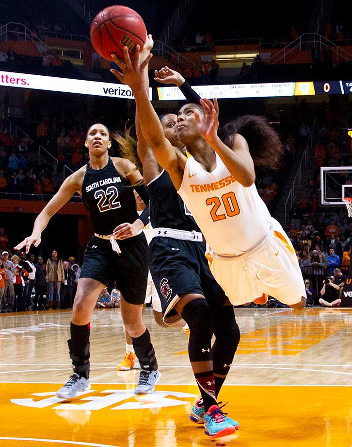Tennessee guard Te'a Cooper puts up a shot past South Carolina's  Tiffany Mitchell.