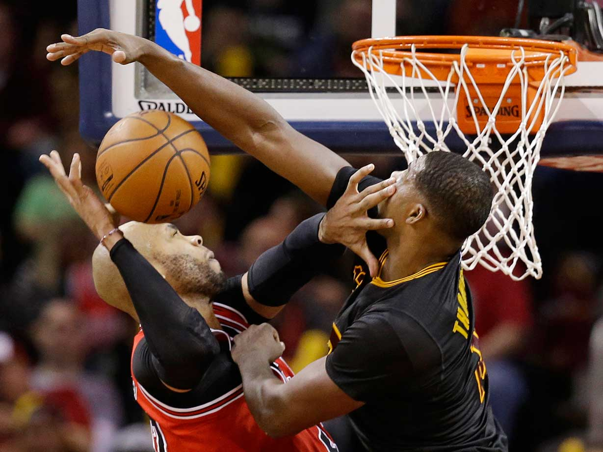 Cleveland's Tristan Thompson fouls Chicago's Taj Gibson.