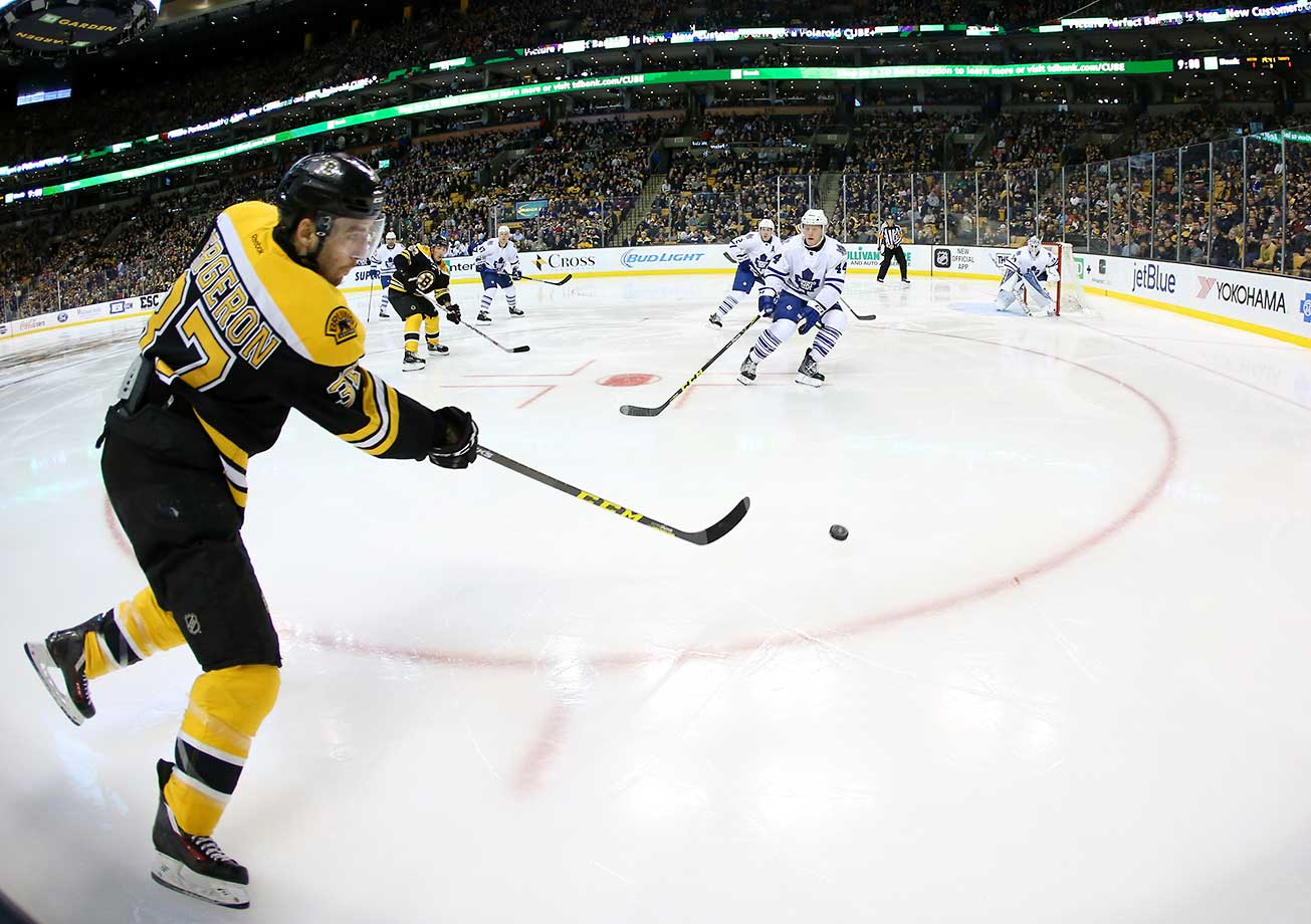 Boston Bruins center Patrice Bergeron fires in a shot from the boards. The Maple Leafs defeated the Bruins 4-3 in overtime at TD Garden in Massachusetts.