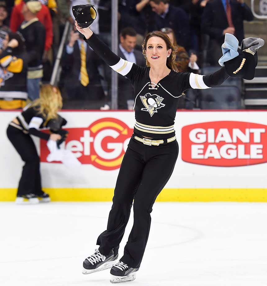 Pittsburgh Penguins ice girls pick up hats thrown after center Sidney Crosby scored a hat trick in a 6-5 win against the Ottawa Senators at the Consol Energy Center in Pennsylvania.
