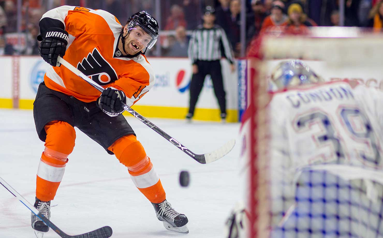 Here are some of the images that caught our eye on the sports night of Feb. 2, starting with Philadelphia Flyers center Sean Couturier fireing a shot at the Montreal Canadiens at the Wells Fargo Center in Philadelphia.