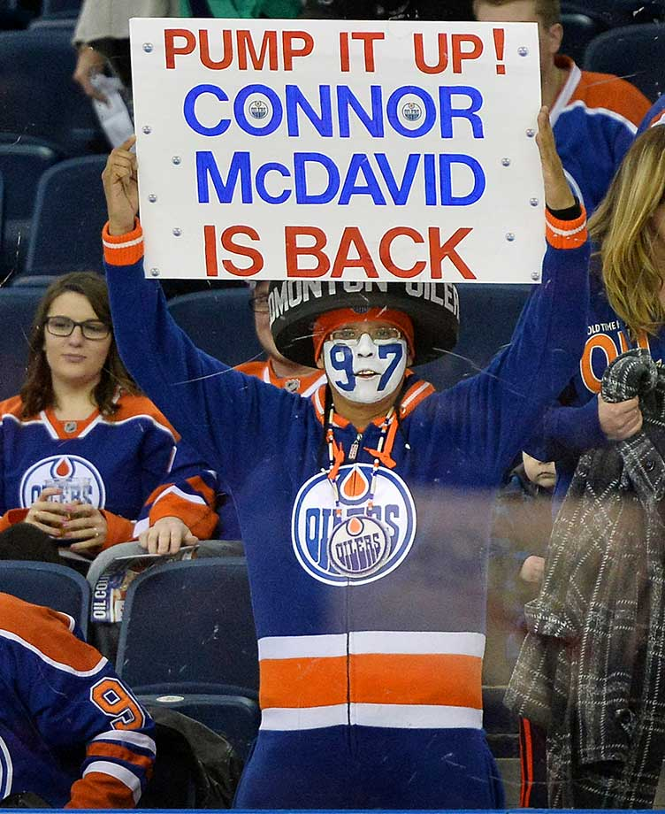 A fan holds up a sign welcoming back Edmonton Oilers center Connor McDavid after his return from the injury he suffered in November.
