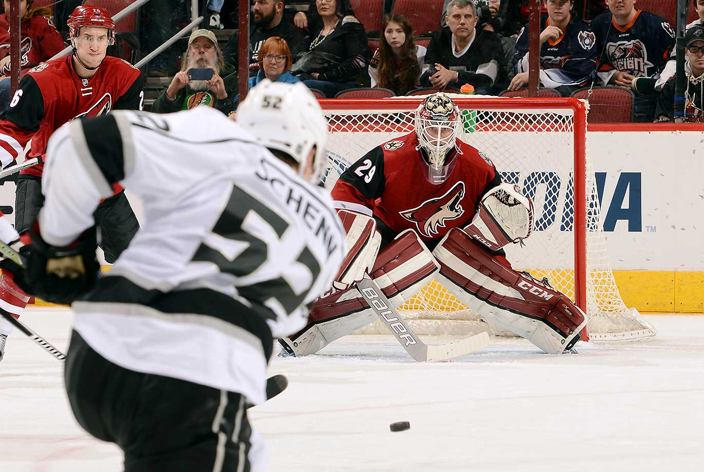 Goalie Anders Lindback of the Arizona Coyotes looks to make a save on the shot by Luke Schenn of the Los Angeles Kings at Gila River Arena in Glendale, Ariz.