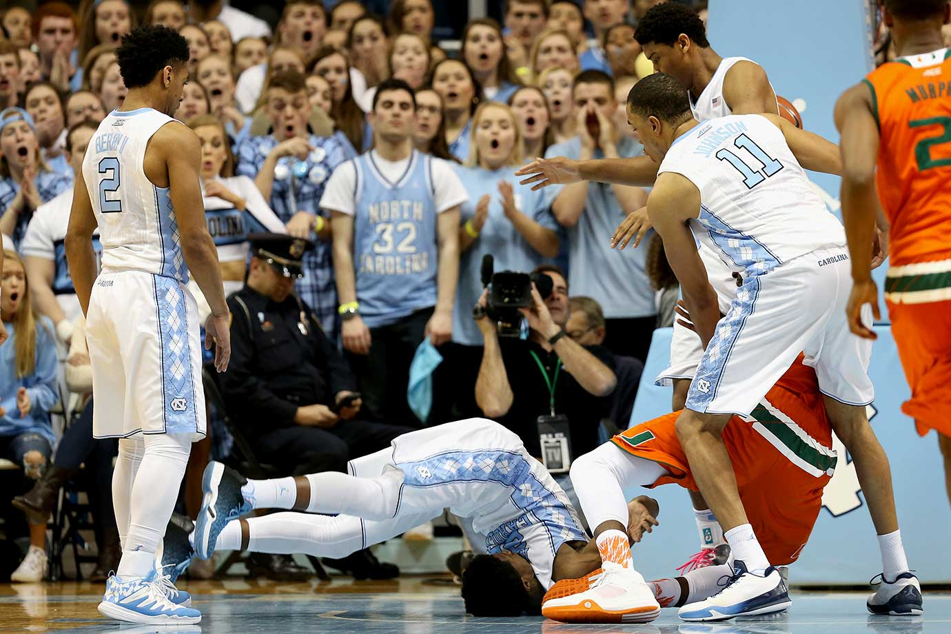Kenny Williams flips over, much to the astonishment of onlookers, but not the security guard, in an afternoon game between Carolina and Miami.
