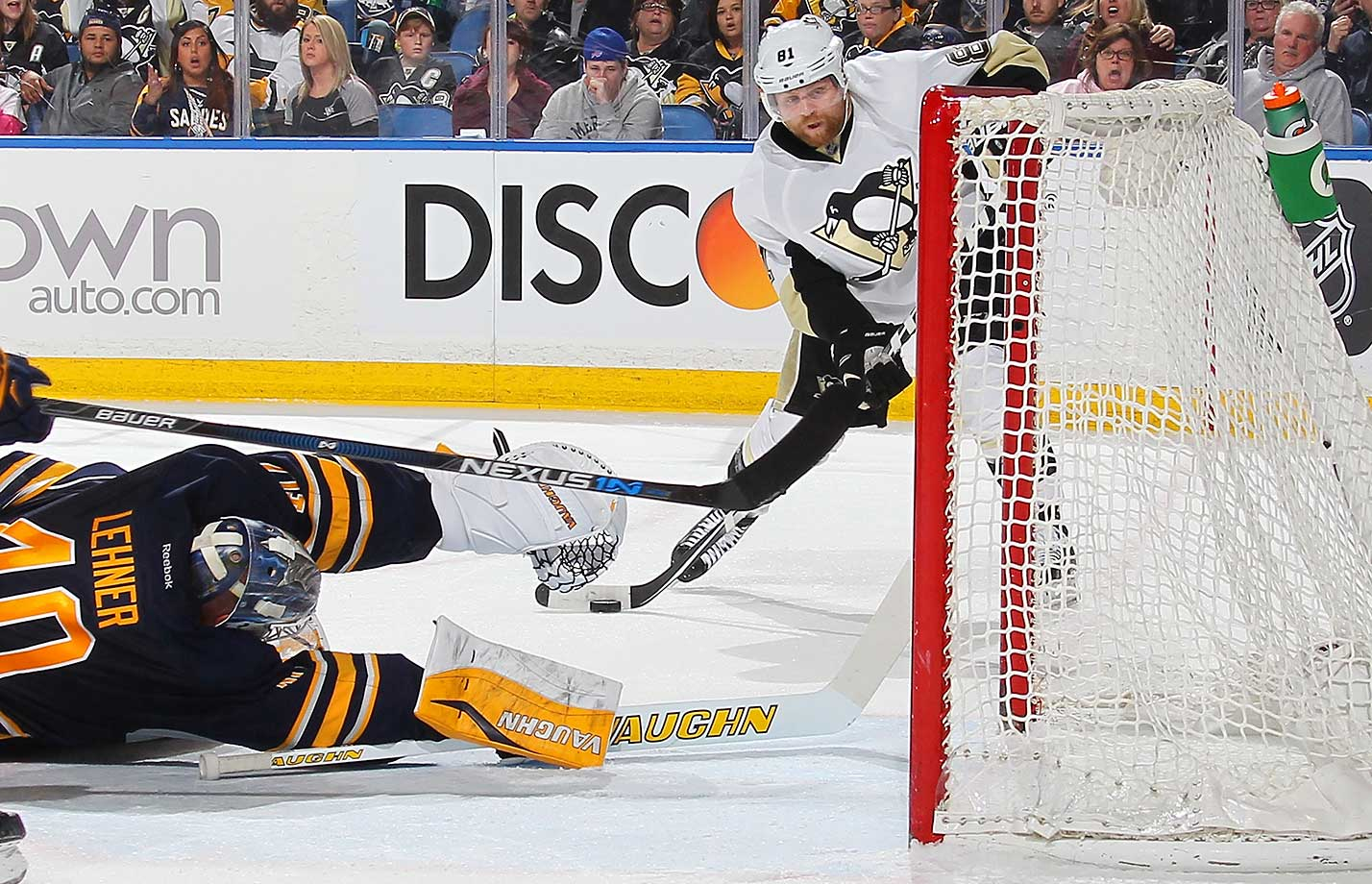 Phil Kessel of Pittsburgh Penguins scores against Robin Lehner of the Buffalo Sabres.