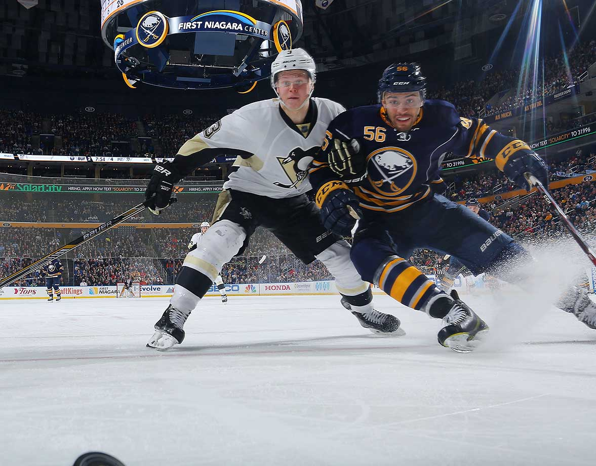 Justin Bailey of Buffalo battles for the puck against Olli Maatta of the Pittsburgh Penguins.