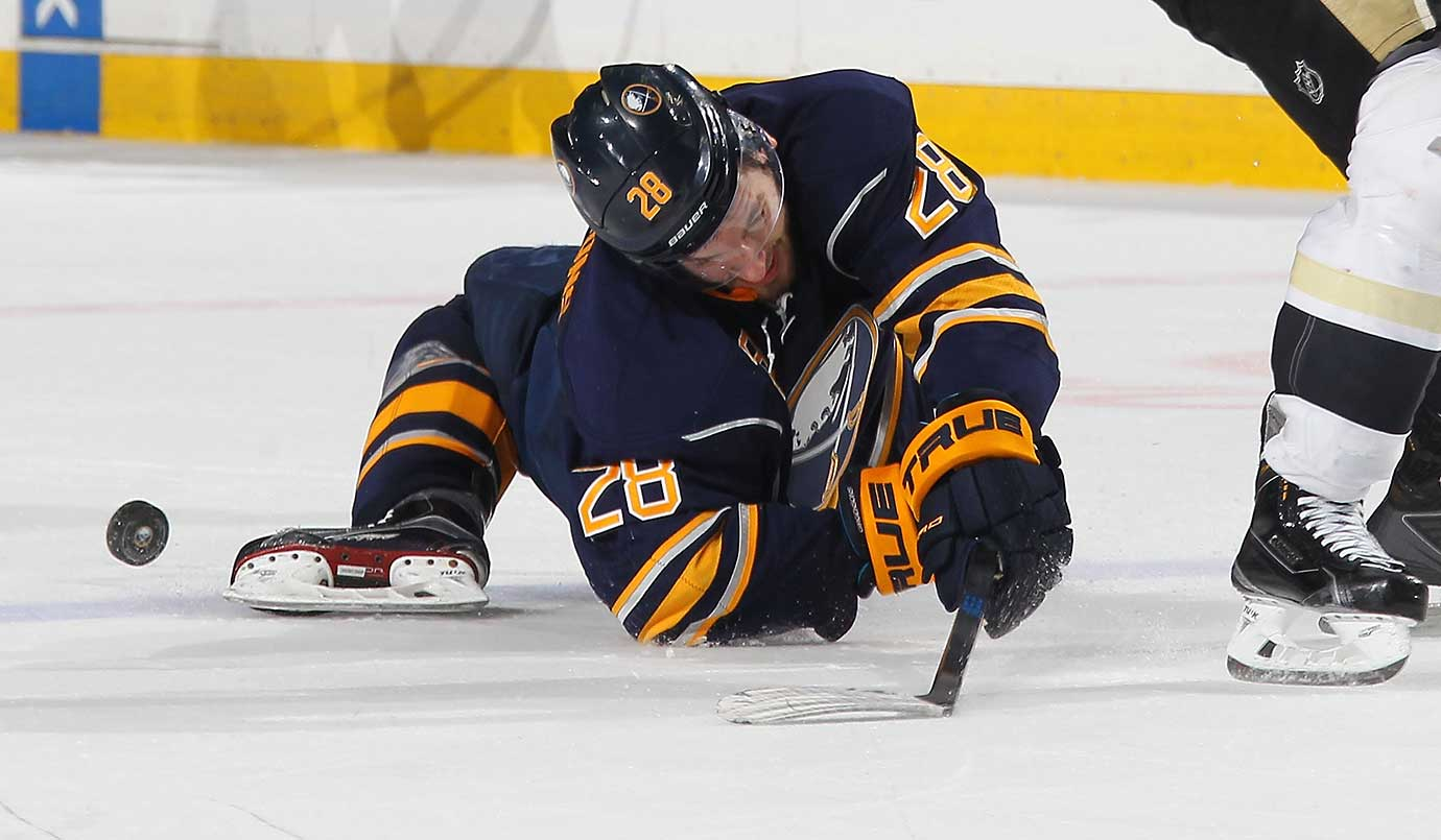 Zemgus Girgensons of Buffalo falls awkwardly after a collision during a game against Pittsburgh.
