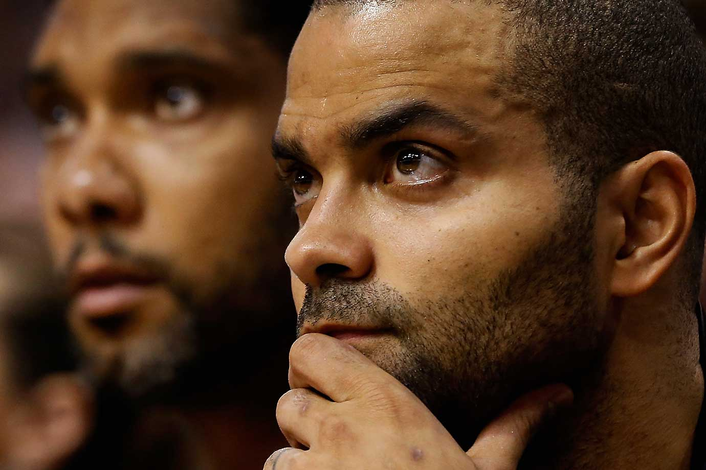 Tony Parker and Tim Duncan of the San Antonio Spurs watch from the bench in a game at Phoenix.