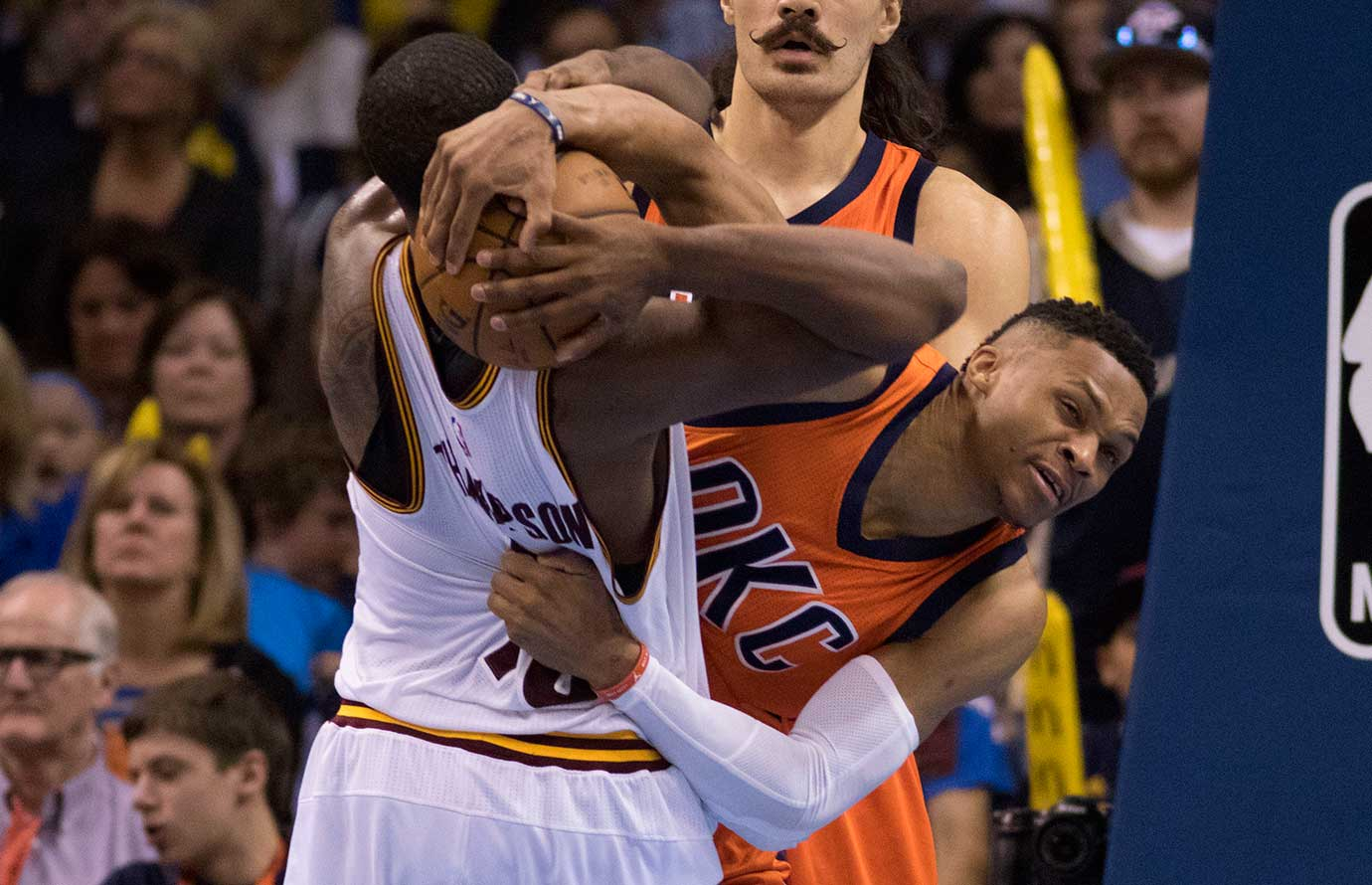 Russell Westbrook tries to wrestle the ball from Tristan Thompson during the Thunder-Cavaliers game.