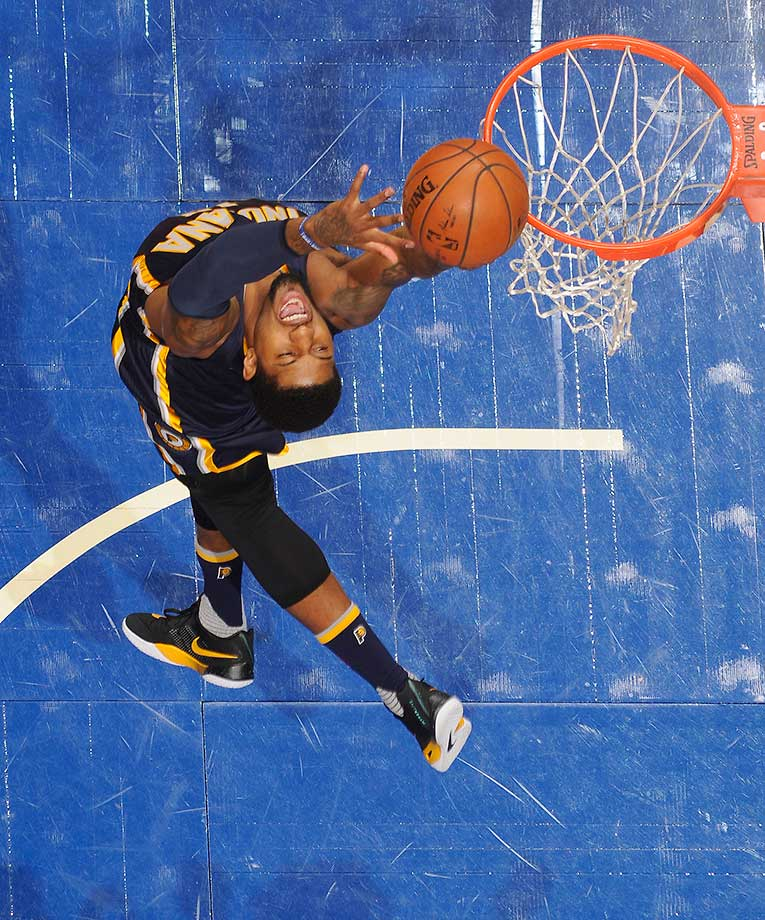 Paul George of the Indiana Pacers grabs a rebound against the Orlando Magic.
