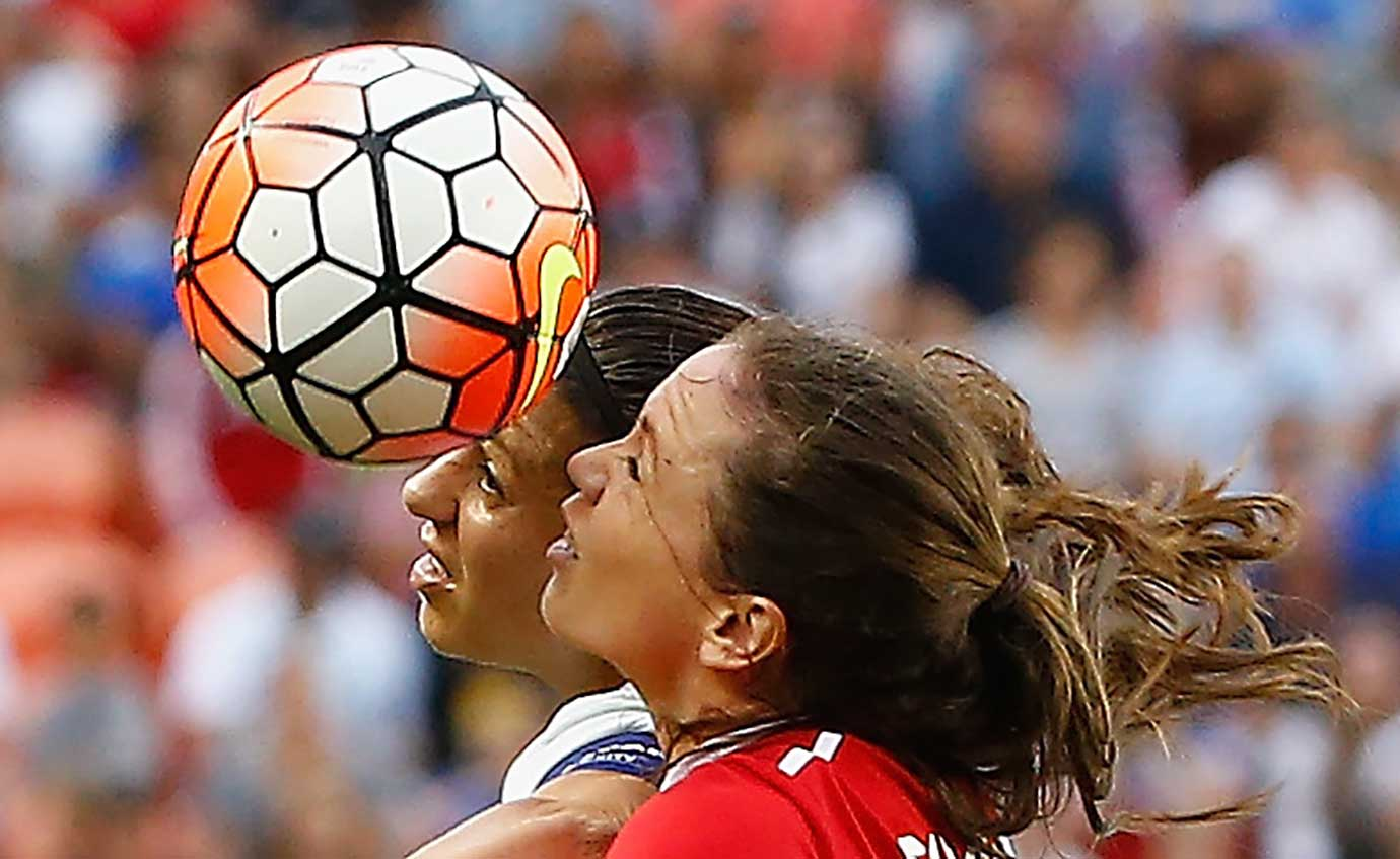 Carli Lloyd of the U.S. goes up against Allysha Chapman of Canada during the championship final of an Olympic qualifying tournament.