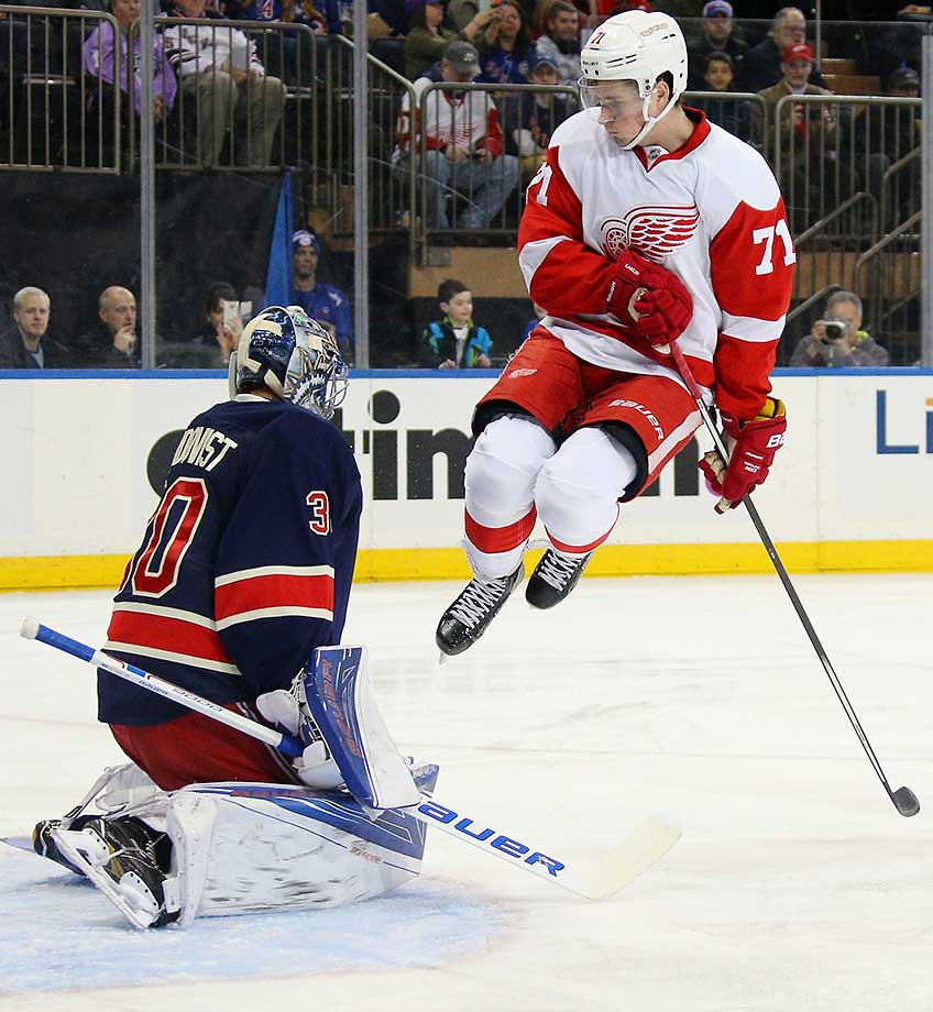 Dylan Larkin of the Detroit Red Wings jumps to screen Henrik Lundqvist of the New York Rangers.