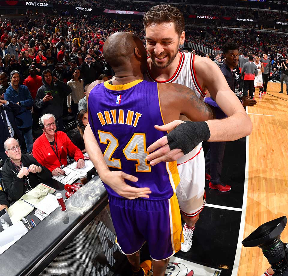 In his last NBA game in Chicago, Kobe Bryant of the Lakers hugs his good friend and former teammate Pau Gasol.