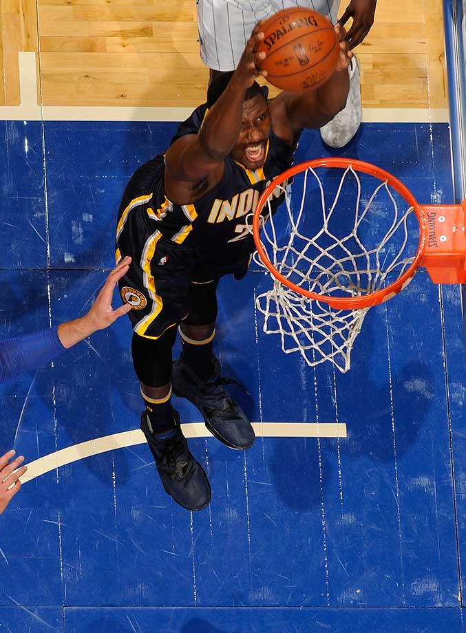 Ian Mahinmi of the Indiana Pacers dunks against the Orlando Magic.