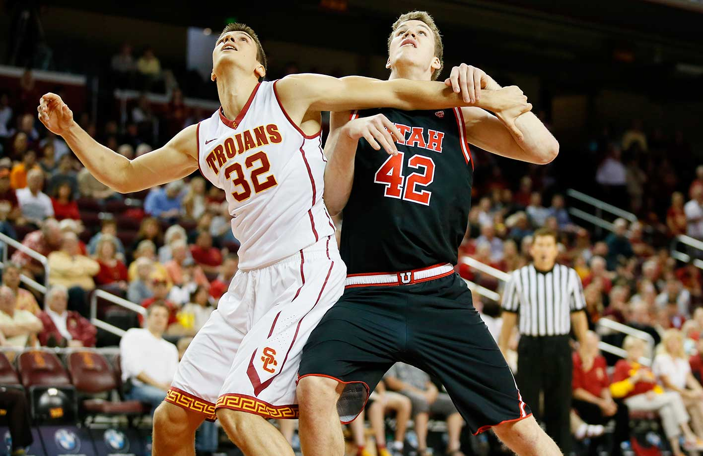 Southern California's Nikola Jovanovic and Utah's Jakob Poeltl battle for position in Los Angeles.