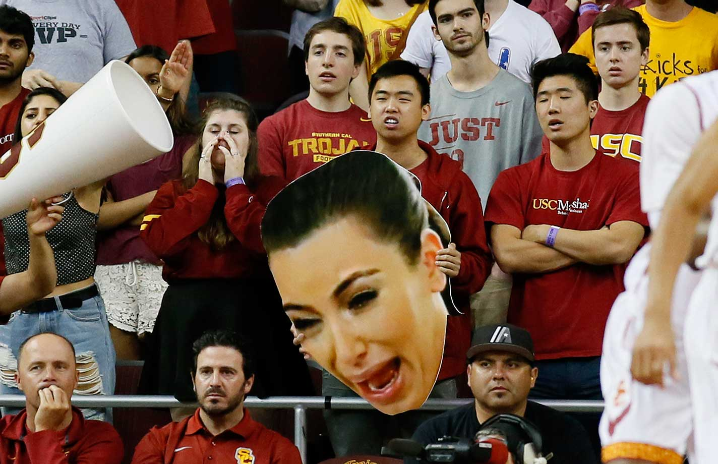 Fans use a large photo of Kim Kardashian as they try to distract Utah. It didn't work as USC lost 80-69.