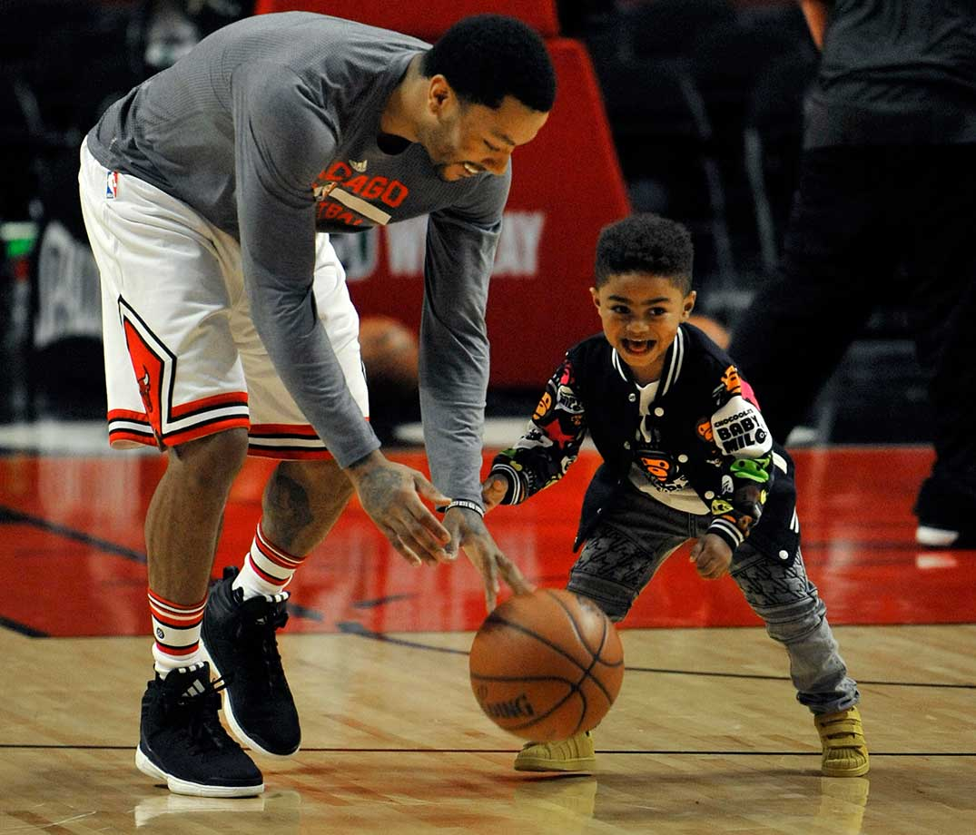 Here are some of the images that caught our eye on the sports night (and late afternoon) of Feb. 21, starting with Derrick Rose on the court with his 3-year-old son P.J.