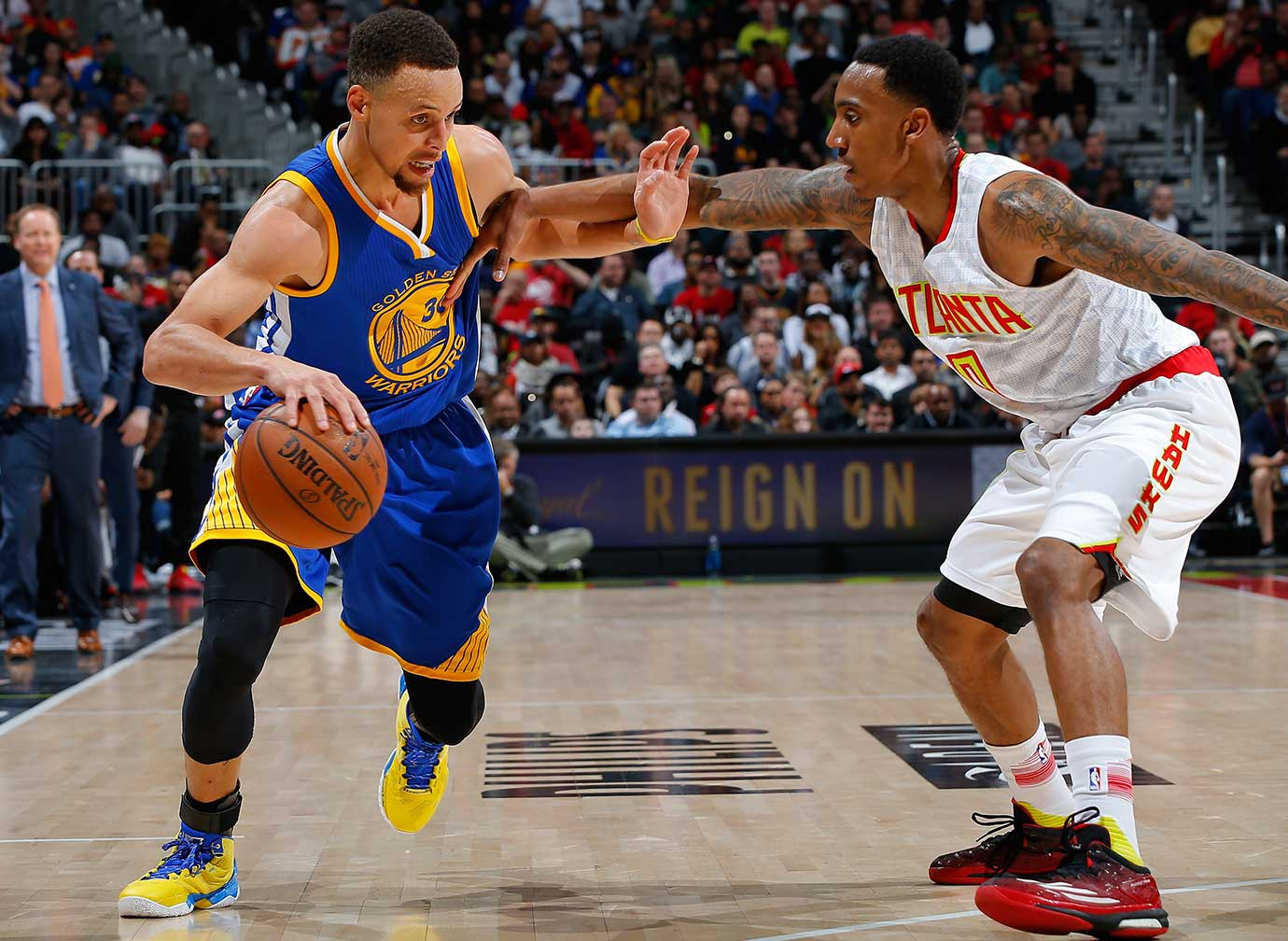 Stephen Curry drives against Jeff Teague of the Atlanta Hawks at Philips Arena.