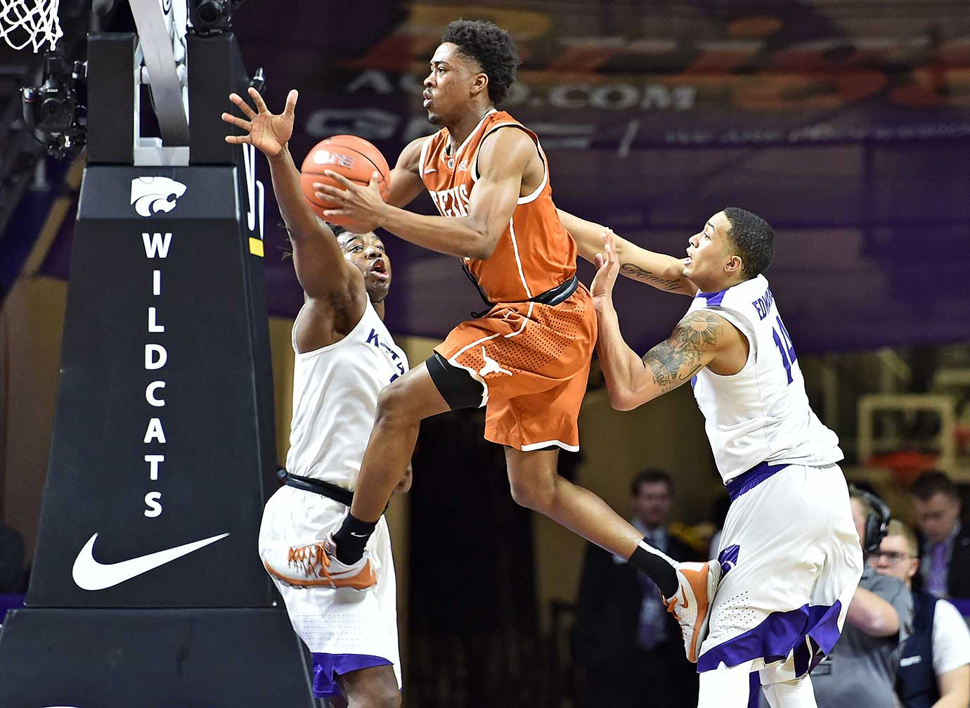 Isaiah Taylor of the Texas Longhorns drives into the lane against Kansas State during a 71-70 victory.