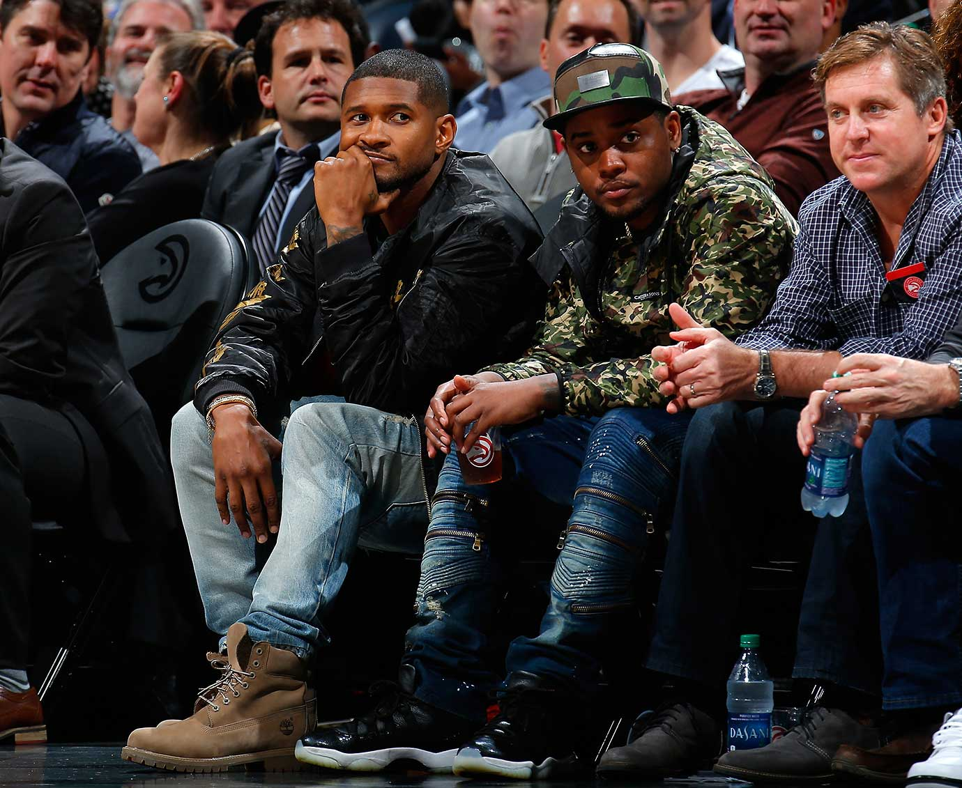 Recording artist Usher looks on during the game between the Golden State Warriors and the Atlanta Hawks.