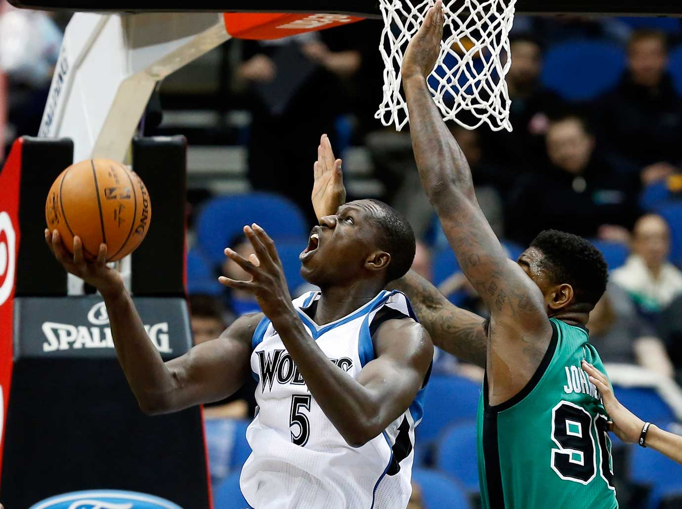 Minnesota Timberwolves' Gorgui Dieng eyes the basket as Amir Johnson of the Boston Celtics defends.