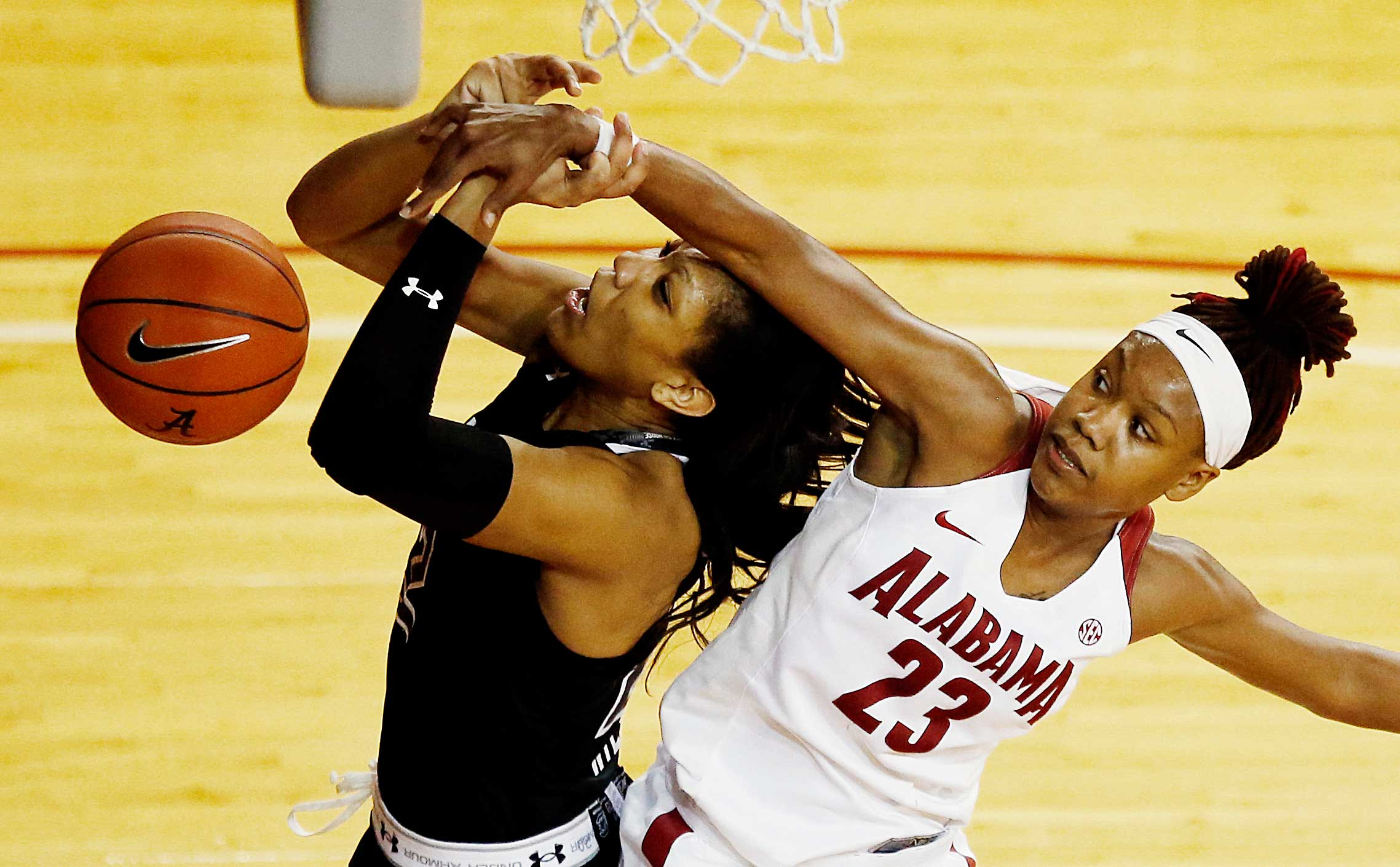 Alabama guard Shaquera Wade fouls South Carolina forward A'ja Wilson.
