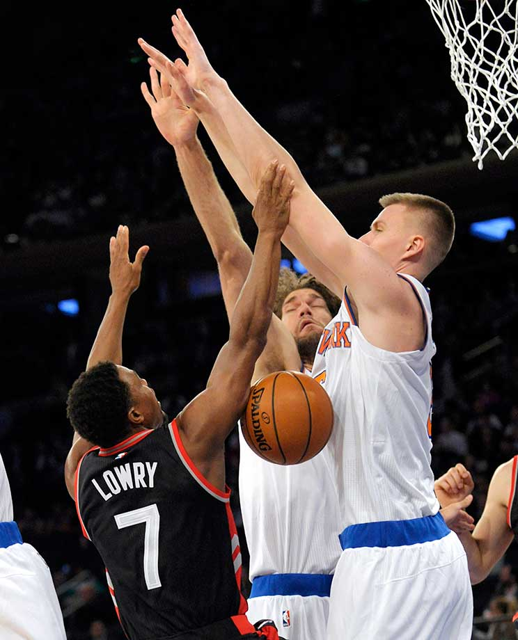 Kristaps Porzingis, right, and Robin Lopez of the Knicks block a shot by Toronto Raptors guard Kyle Lowry.