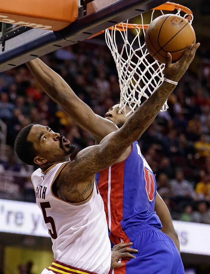 Cleveland's J.R. Smith drives to the basket against Andre Drummond of Detroit.