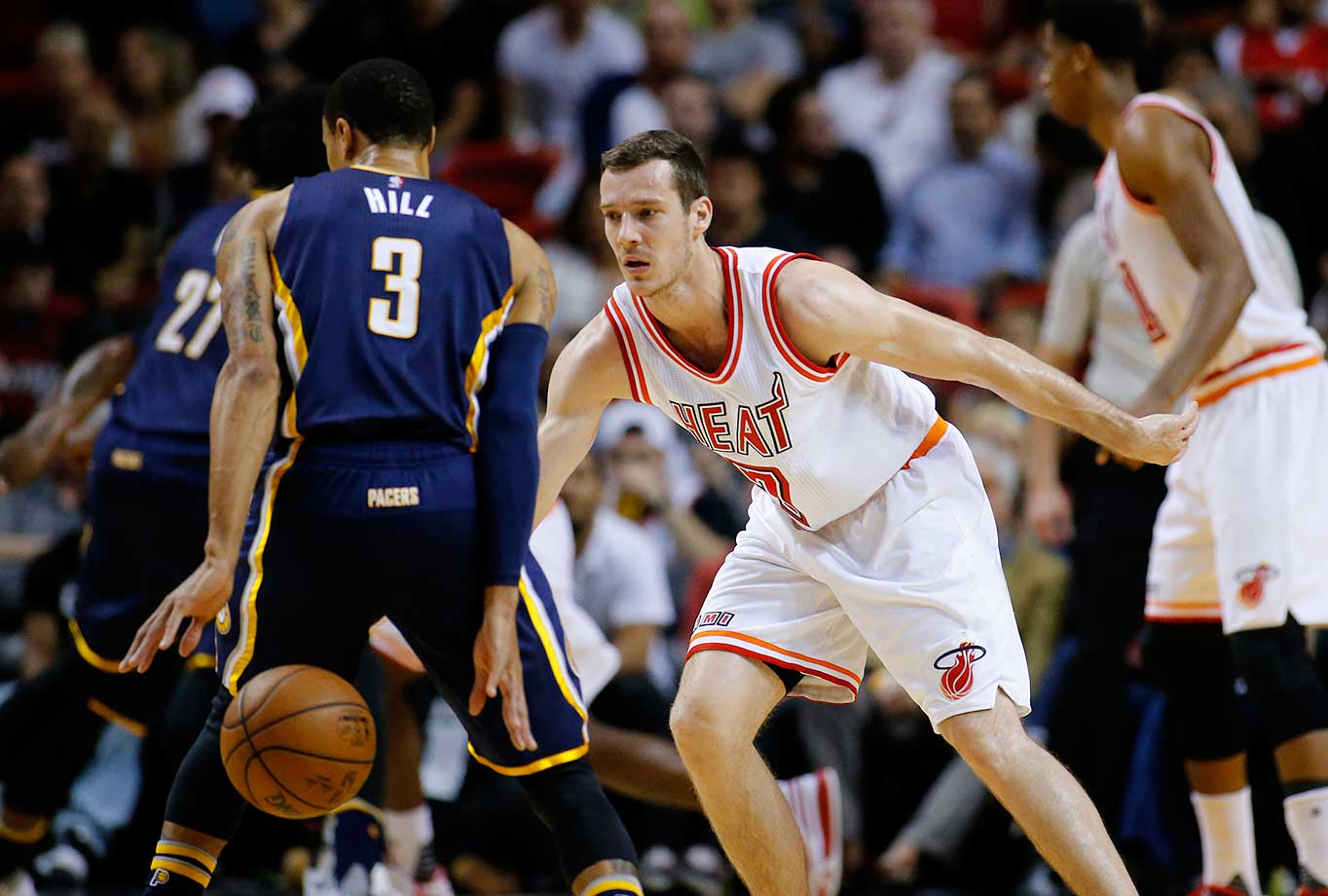Indiana Pacers George Hill dribbles the ball behind this back while defended by Goran Dragic of Miami.