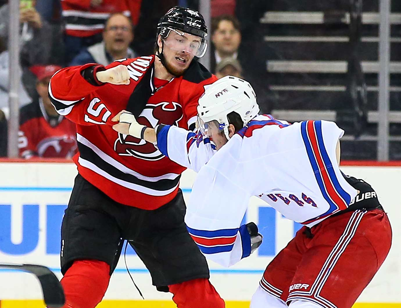 New Jersey Devils center Sergey Kalinin (51) fights with New York Rangers center J.T. Miller.