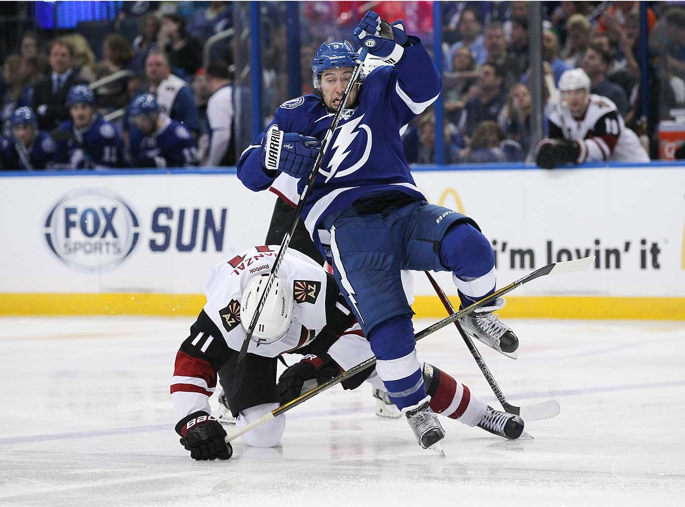 Tampa Bay Lightning center Tyler Johnson draws a penalty for embellishment as he is tripped by Arizona Coyotes center Martin Hanzal.