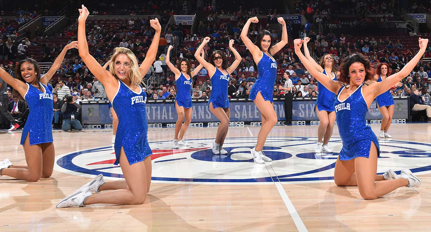 The Philadelphia 76ers dance teams perform for the crowd during their team's game against the Orlando Magic.