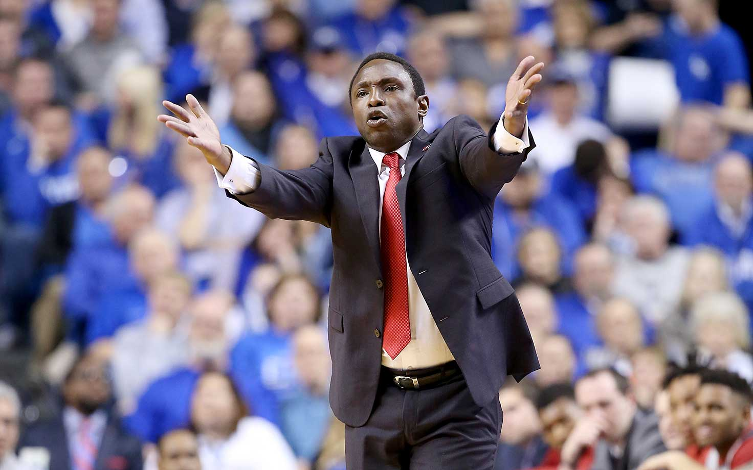 Avery Johnson, head coach of the Alabama Crimson Tide, gives instructions to his team during a game at Kentucky.