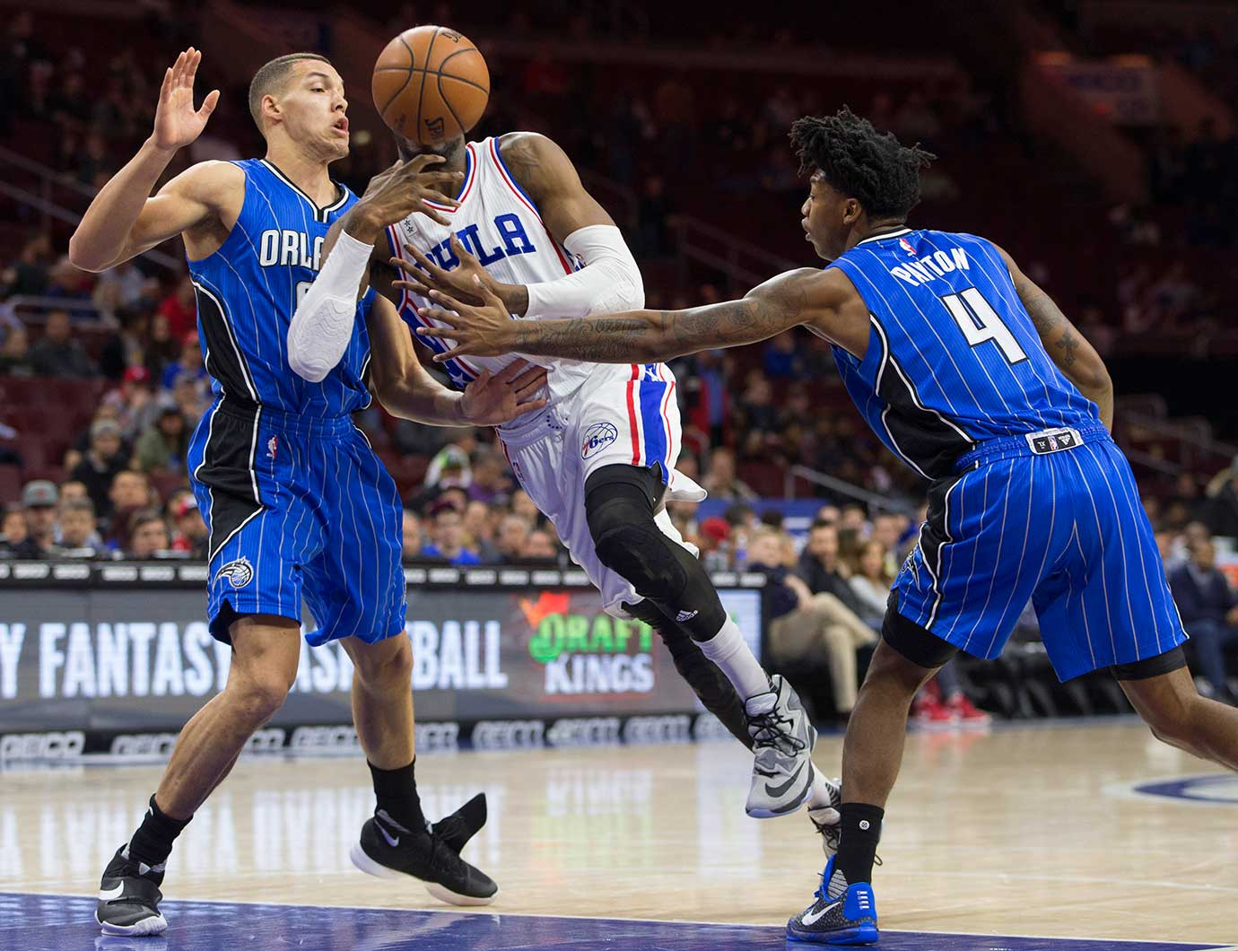 Nerlens Noel of the Philadelphia 76ers loses control of the ball against Aaron Gordon, left, Elfrid Payton of the Orlando Magic.