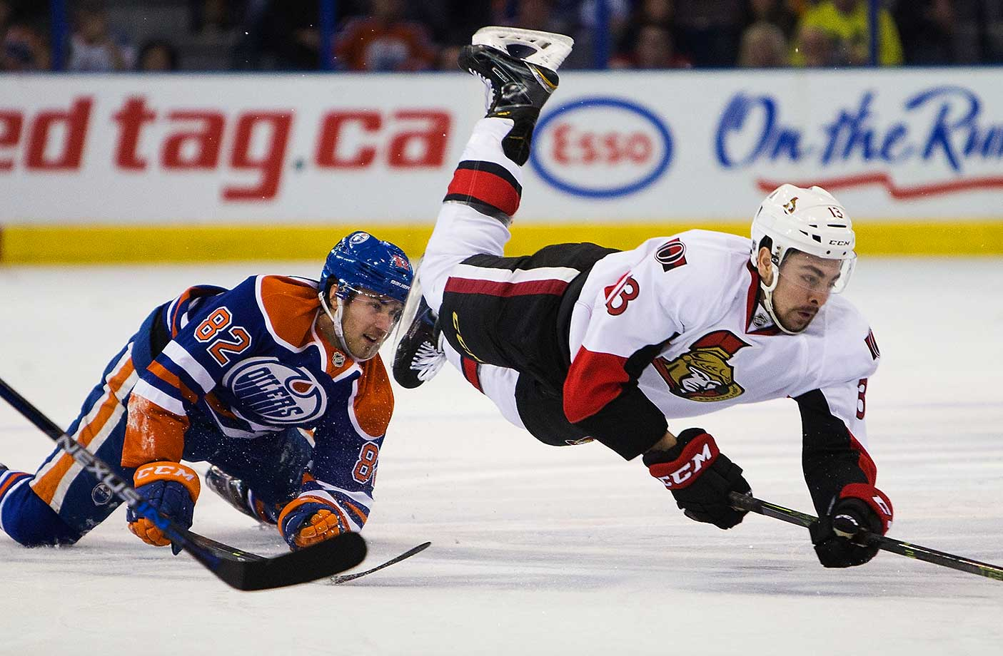 Jordan Oesterle of the Edmonton Oilers trips up Nick Paul of the Ottawa Senators.