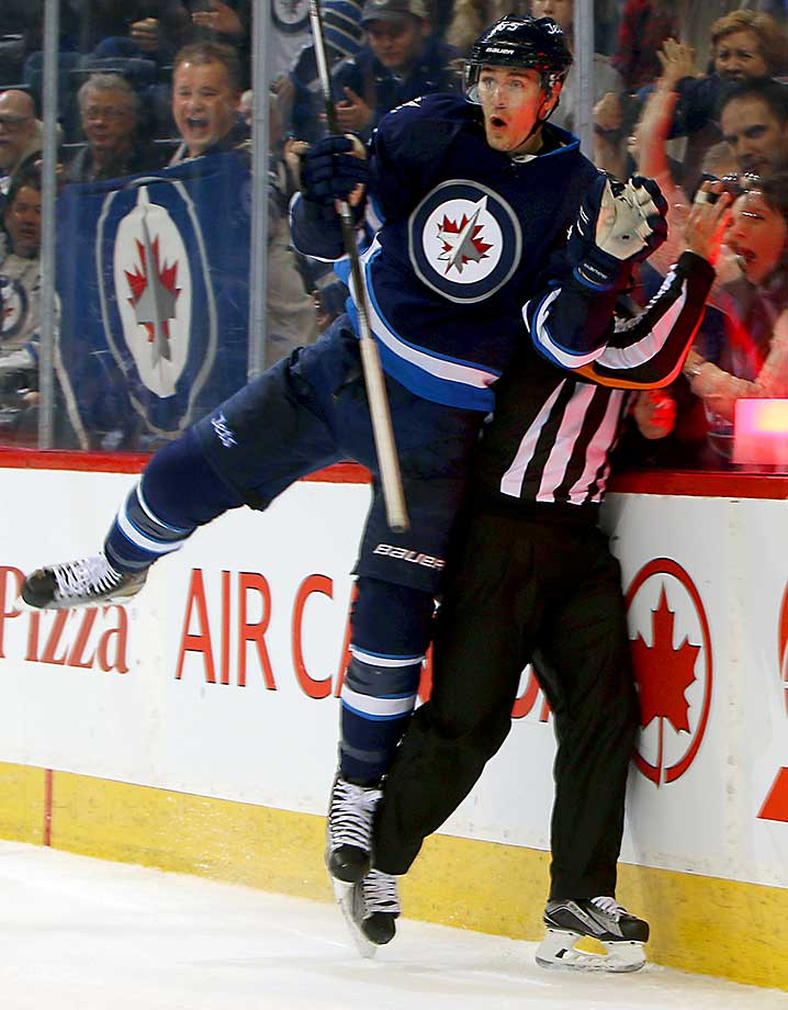Mark Scheifele of Winnipeg pins an official against the glass while celebrating a goal against the Dallas Stars.