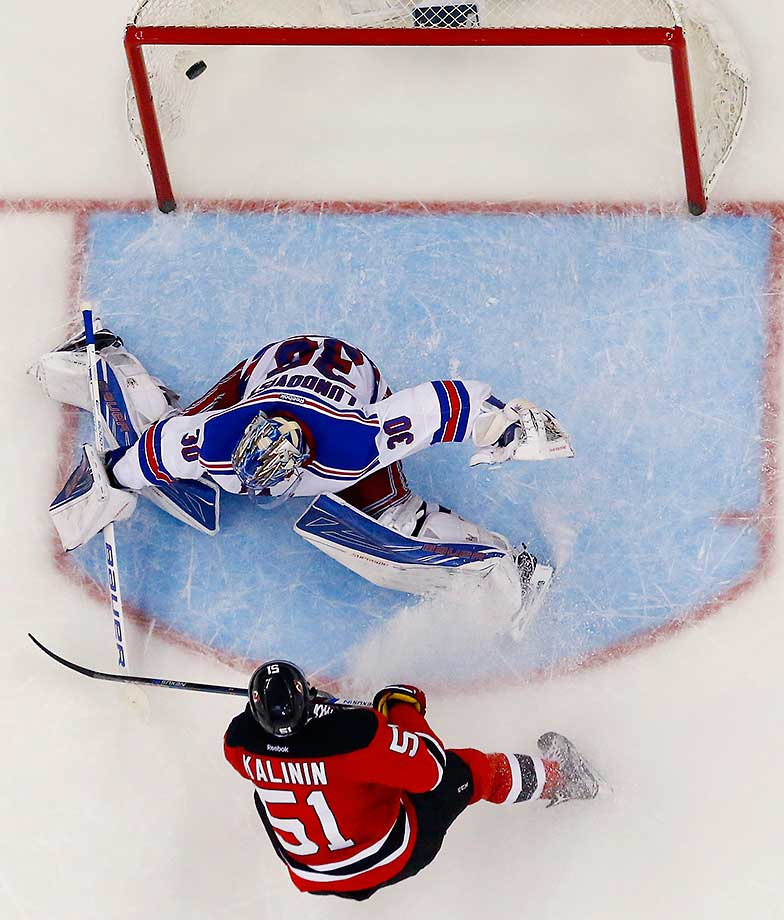 Cedric Paquette of the Tampa Bay Lightning scores during a penalty shot against Louis Domingue of the Arizona Coyotes.