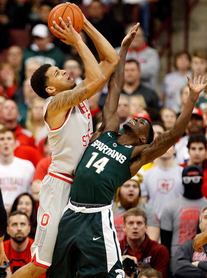 Ohio State's Marc Loving shoots over Michigan State's Eron Harris.