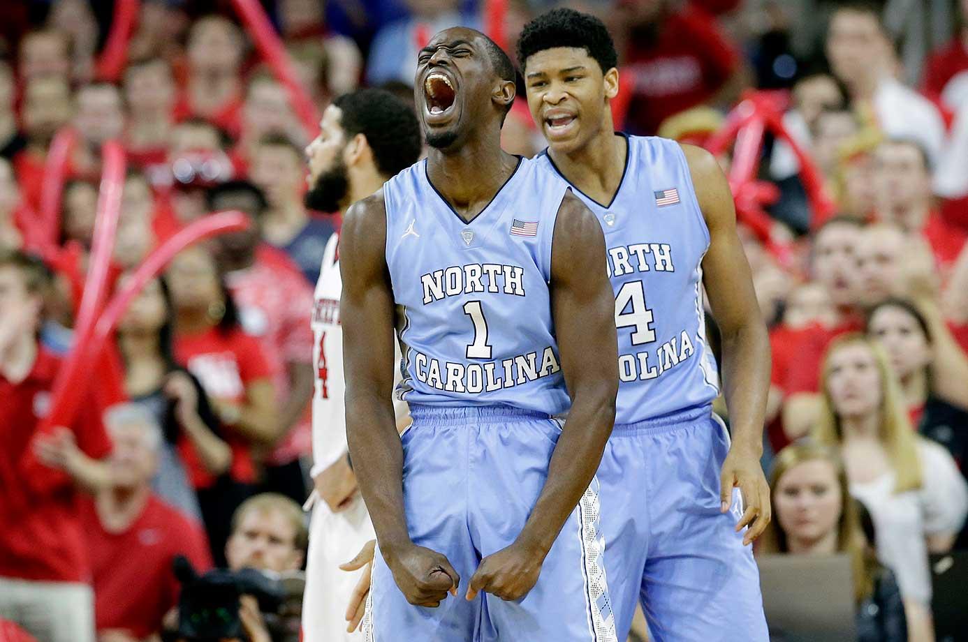 North Carolina's Theo Pinson (1) and Isaiah Hicks react following Pinson's basket against North Carolina State.