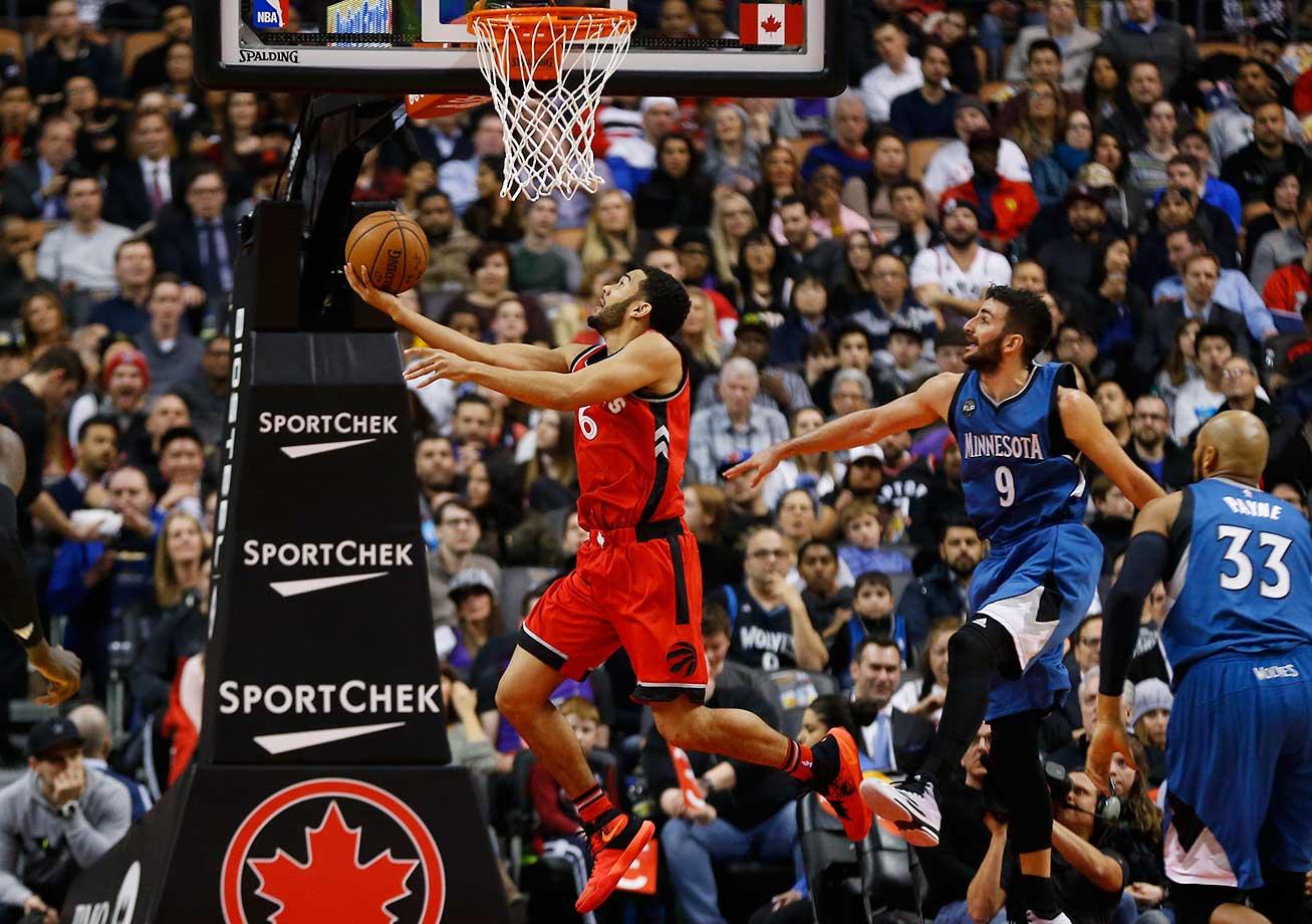 Toronto Raptors guard Cory Joseph gets past Minnesota's Ricky Rubio and Adreian Payne for a basket.