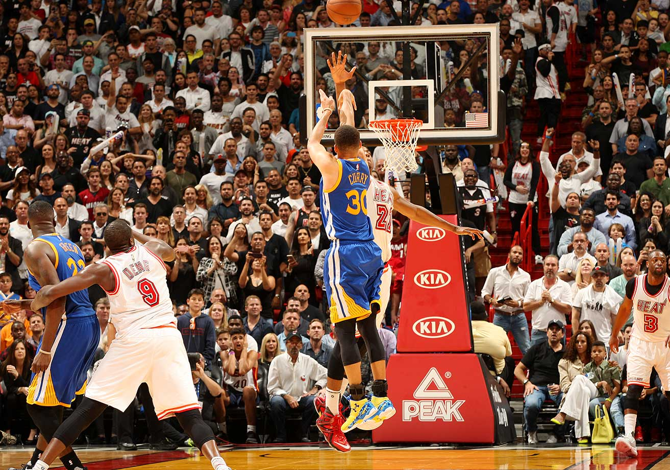 Stephen Curry hits a three against Miami on a night when he tied the NBA record for consecutive games with a made three: 127.