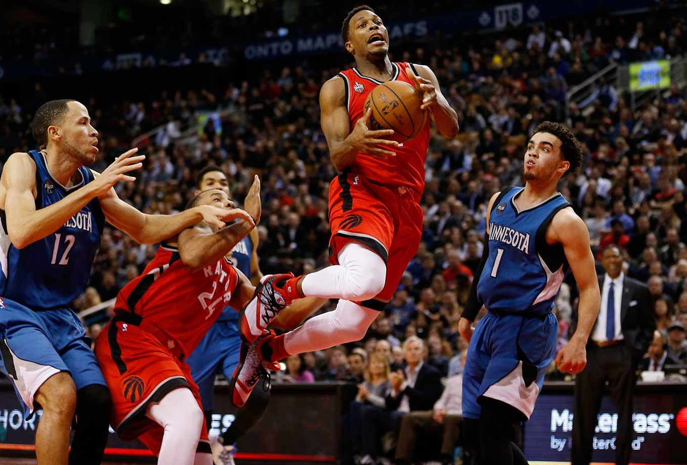 Toronto Raptors guard Kyle Lowry flies to the basket against the Minnesota Timberwolves.