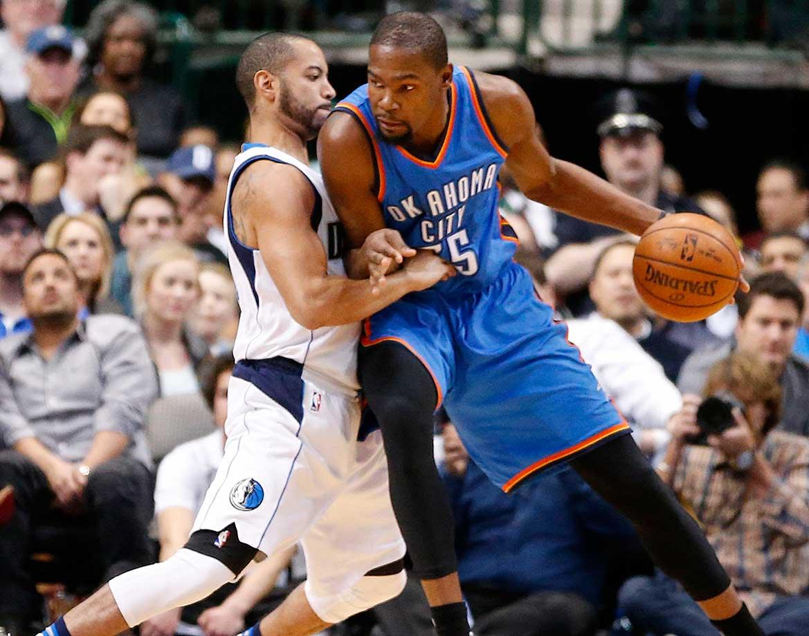 Kevin Durant of Oklahoma City drives against the Dallas Mavericks' Deron Williams.